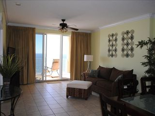 Tropic Winds condo photo - Living Room with Comfy Queen Sofa Bed and huge flat screen TV and DVD Player.