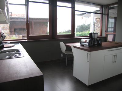 Punta del Este house rental - Spacious kitchen with garden view.