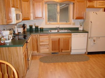 Large kitchen is well equipped.