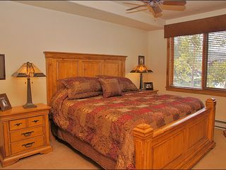 Steamboat Springs condo photo - King Master with Ensuite Bathroom, TV, & plush linens.