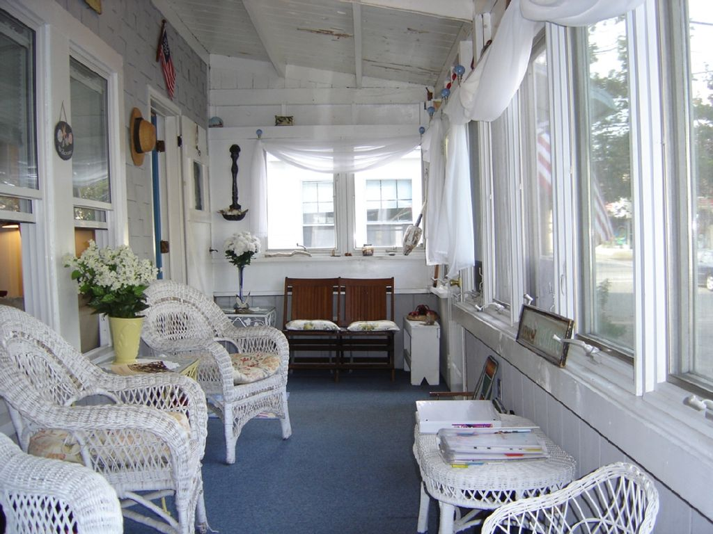 Just steps to beautiful old orchard beach homeaway for Enclosed front porch pictures