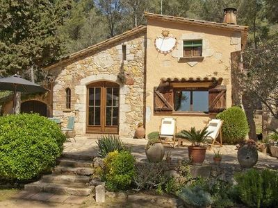 A house on the Costa Brava with a 5,000 m2 private garden and woods.