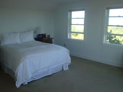 Upstairs master bedroom...sliding glass doors on opposite wall open to deck