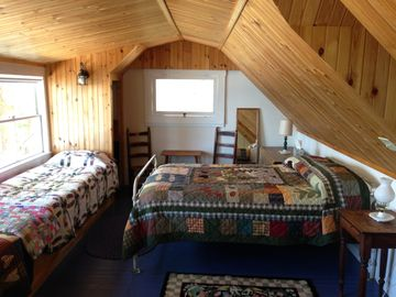 2nd floor bedroom with full bed, 2 built in cots, and a lake view.