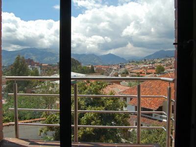 Balcony off of the dining area. Large avocado trees in yard next door are quite tempting