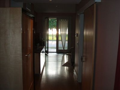entry hall from view through front door to park and river