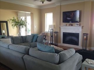 Galveston villa photo - Spacious living room with fireplace, flat screen TV and surround sound stereo