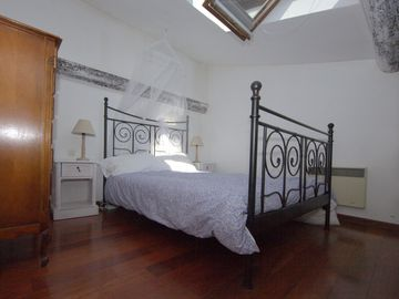 Mezzanine bedroom. Fall asleep looking at stars. Fan & mosquito net included.