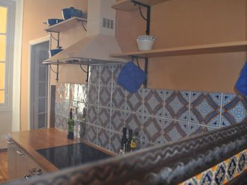Kitchen with hand painted Italian tiles