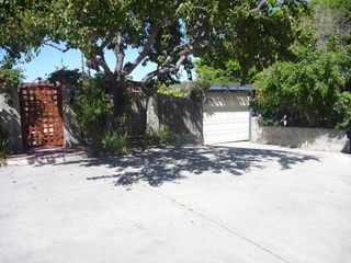 La Jolla house photo - Large driveway with front gate, and garage door to carport.