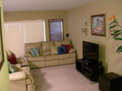 Palm Harbor condo rental - Leather sleeper sofa & leather dual side-by-side recliners with console. HDTV