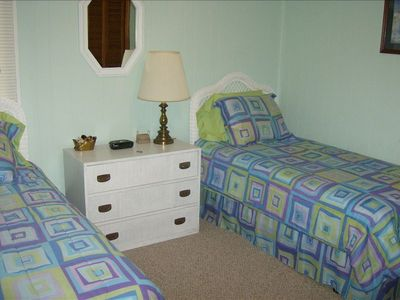 Second bedroom with twin beds & ceiling fan
