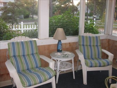 Comfy chairs on the screened in porch for after beach relaxing