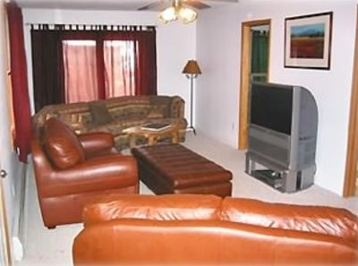 Family Room with Big Screen TV and Leather Couches