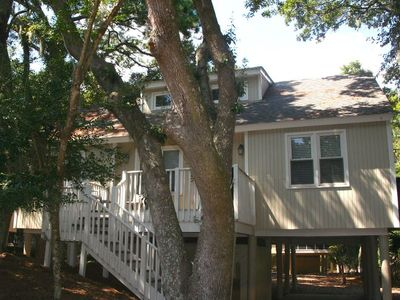 Welcome to 529 Tarpon Pond - a lovely cottage nestled amid live oaks and palms.