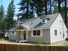 Large fenced-in yard for pets & kids & hot tub fun - Tahoe Valley house vacation rental photo