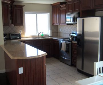 Brand new gourmet kitchen with Granite Counters