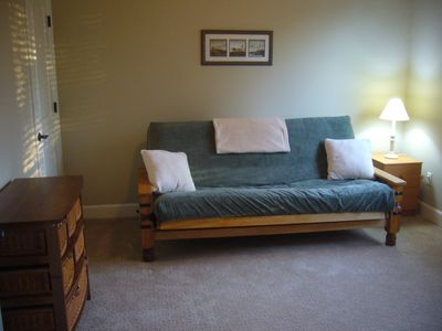 Bonus Room with Futon Couch, TV, Dresser and Closet.