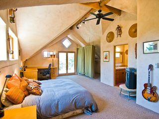 Taos house photo - The master bedroom with sunset light pouring in off the 800 sq ft Taos view deck