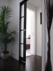 Sliding Door Between Bedroom Area & Family Room Area