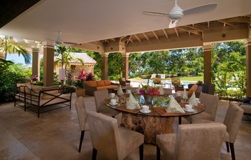 The comfortable outdoor room is a popular area for living, dining, reading & fun