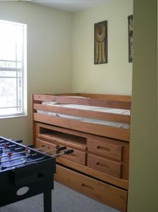 fourth bedroom, with bunk beds on left side, and upper bed, with trindle (shown)