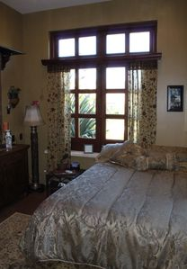This is our ground floor garden-view room. It is cozy, with a full size bed.