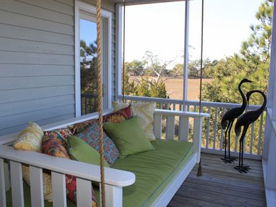 screen porch with hanging bed