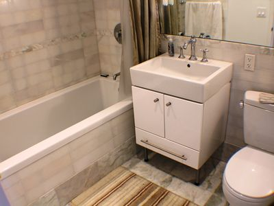 White Marble Bathroom with extra deep tub for those soothing bubble baths!