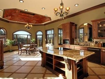 Kitchen Island with flat cooktop and large breakfast area