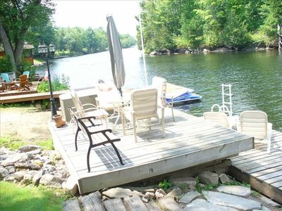 Severn Bridge cottage rental - View of private dock & patio looking west down river