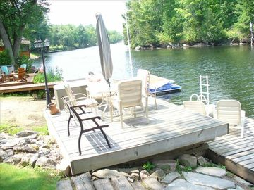 View of private dock & patio looking west down river