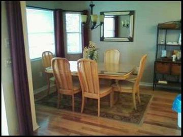 dining room with real wood floors