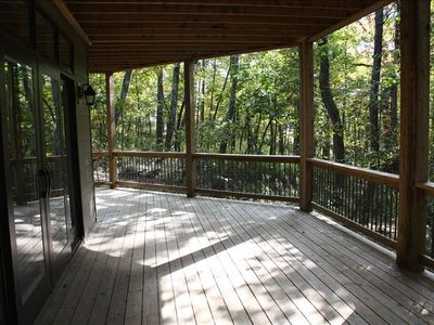 First level deck with gated side entrance to den
