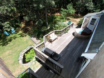 View of backyard from second floor deck. Great for cookouts and kid's play area.
