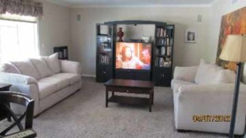 "Family room with 50"" TV and sleeper sofa"