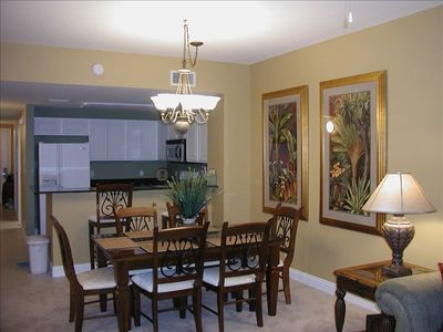 Full size kitchen with granite countertops and large dining area