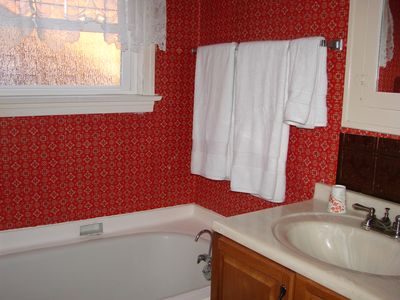 Bath 2 with classic tub and decor.