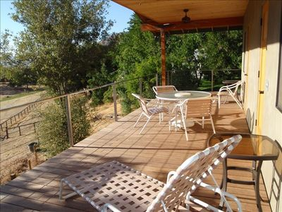 View Deck. Overlooking pastures & Grouse Creek. Direct access from both bedrooms