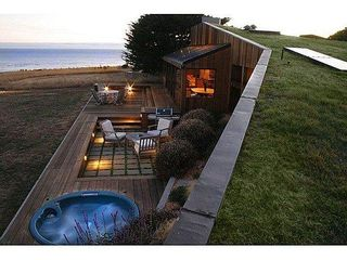 Sea Ranch house photo - An evening view from the sod roof overlooking the back yard deck.