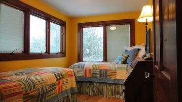 Bright Summer Sun Bedroom With Two Twin Beds.