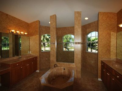 Huge Luxury Master ensuite complete with Marble jacizzi tub and walk thru shower