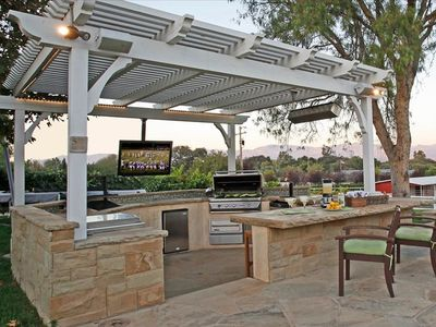 Outdoor kitchen w/ flat screen TV