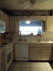 Langley house photo - Fully equipped kitchen, dynamic view of lake. microwave, dishwasher coffee maker