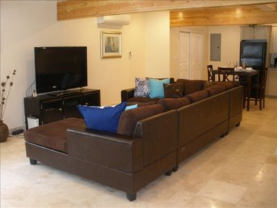 Sectional sofa with 55 inch HDTV