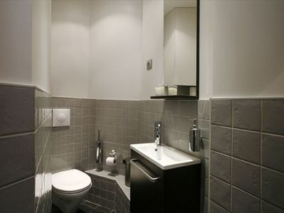 Secondary bathroom (toilet and sink) - Secondary bathroom (toilet and sink).  The bathroom is accessible directly from the living room for guests staying in the pull out sofa in the living room or visiting you.  They will not have to go through the master bedroom.