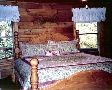 A country style room with king bed located on the main floor has private bath.