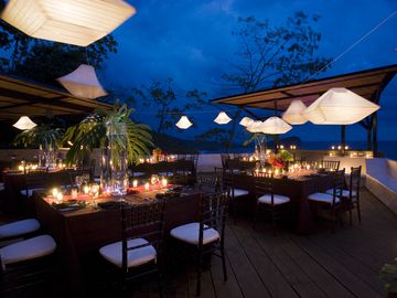For a wedding, suspended lanterns create a beautiful outdoor dining experience.