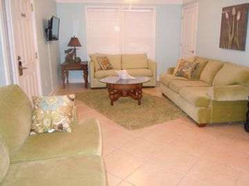 Another sitting area with 2 queen sleeper sofas and flat screen TV.