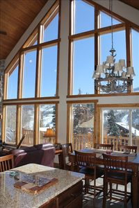 The 25-foot vaulted ceiling and glass-windows provide exceptional views